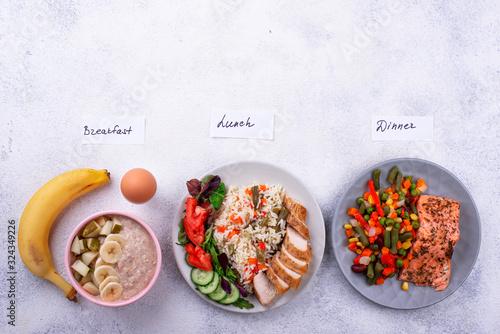 Fototapeta Breakfast, lunch and dinner. Day menu obraz