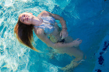 A Teenage Girl Swimming In A P...