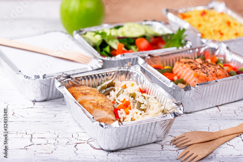 Food delivery concept. Lunch in container - 324353411