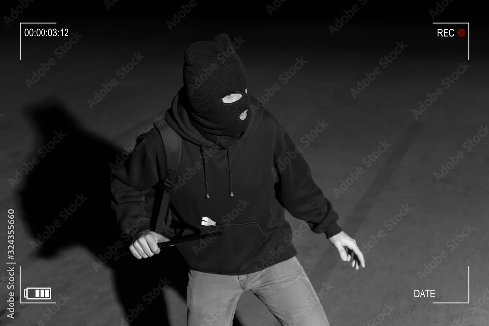 Fototapeta Robber Prepared For Crime In Dark Alley