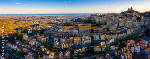 Beautiful aerial scenic view of Guaita fortress on Monte Titano with San Marino city in background at sunrise. Beautiful country of San Marino historical center. Castle on top of the hill.