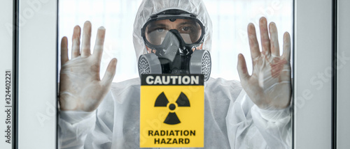Fotografía scientist with coverall protection clothing and full face protection mask in con