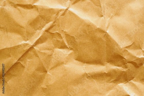 Vászonkép Brown crumpled paper recycled kraft sheet texture background