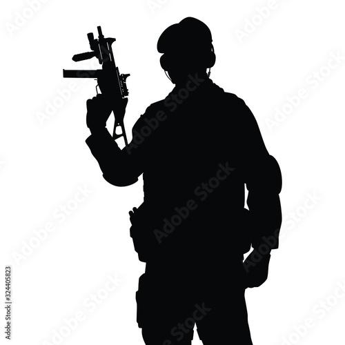 Fotografía Commando special force with weapon silhouette vector