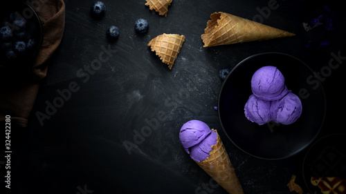 Top view of summer dessert with blueberry flavour ice-cream on black desk background