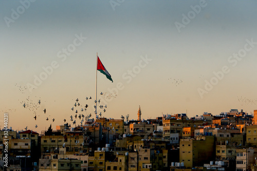 Amman, Jordan sunset with flagpole and birds Canvas Print