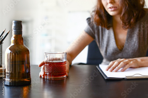 Young drunk woman in office. Concept of alcoholism Canvas Print