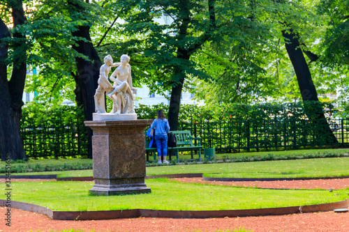 Photo Sculptural composition Satyr and Bacchante in old city park Summer Garden in St
