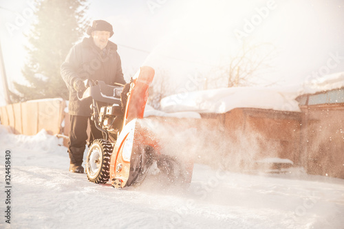 City service cleaning snow winter with thrower blower machine after snowstorm ya Wallpaper Mural