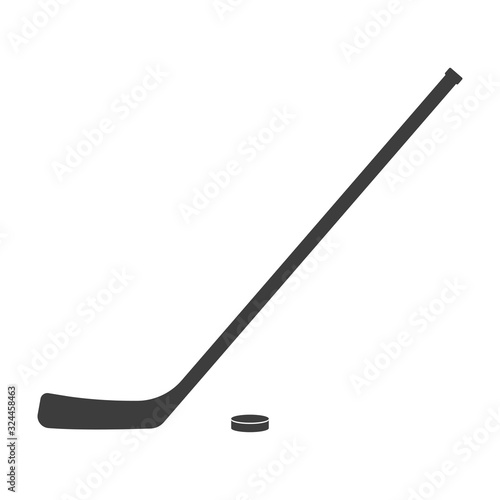 Fototapeta Ice hockey stick and puck icon or black silhouette isolated on white background. Sport equipment symbol. Vector illustration. obraz