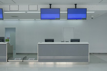 Airport Check-in Counter With Monitor Screens Hanging