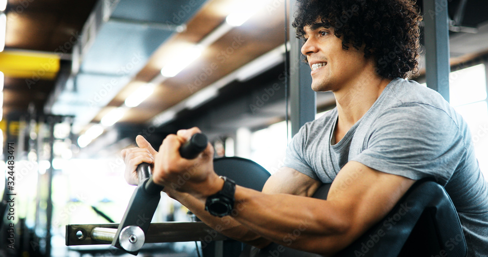 Fototapeta Portrait of healthy fit man working out in gym