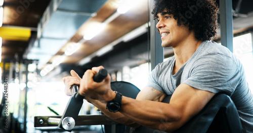 Fototapeta Portrait of healthy fit man working out in gym obraz