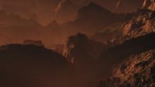 Rugged Mountains At Hazy Sunset.