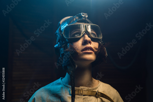 Fotomural Mad Woman In A Straitjacket And A Pilot Helmet With Glasses