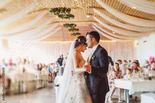 Fototapeta Happy just married young couple at the first wedding dance obraz