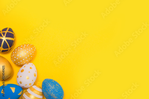 Fototapeta Easter golden decorated eggs on background. Minimal easter obraz