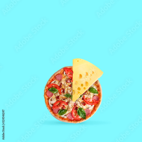 Fototapeta Double cheese. Pizza with tomatos and spices with big cheesy peace on blue background. Copyspace. Modern design. Contemporary artwork, collage. Concept of food, nutrition, taste, wishes, dreams. obraz