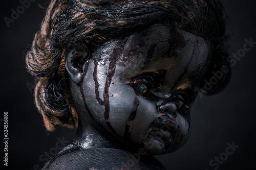 Photo Creepy bloody doll in the dark