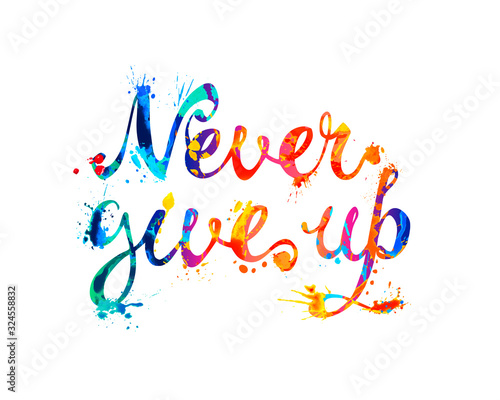 Photo NEVER GIVE UP. Motivation inscription of calligraphic letters