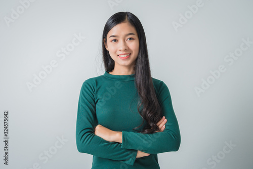 Fototapeta Beautiful young asian woman smiling and looking happily. obraz