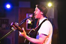 A Nice Man Playing Guitar At A Bar