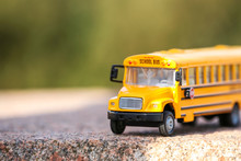 Yellow Toy School Bus Outdoors...
