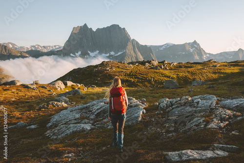 Woman traveler hiking in mountains with backpack adventure travel healthy lifestyle active summer vacations explore Norway
