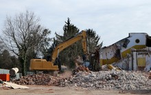 Large Excavator On Heap Of Deb...