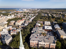 Aerial View Of Historic Center Of Savannah, Georgia With Church Steeple In Foreground.