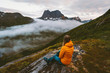 Woman relaxing alone in mountains travel adventure healthy lifestyle outdoor girl enjoying landscape in Norway hiking activity summer vacation
