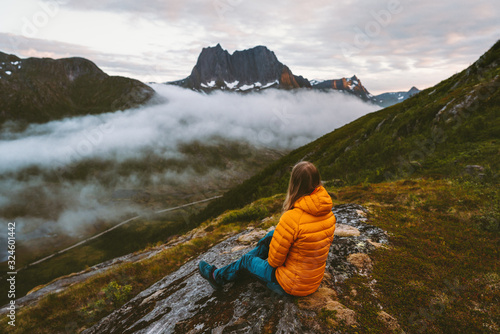 Fototapeta Woman relaxing alone in mountains travel adventure healthy lifestyle outdoor girl enjoying landscape in Norway hiking activity summer vacation obraz