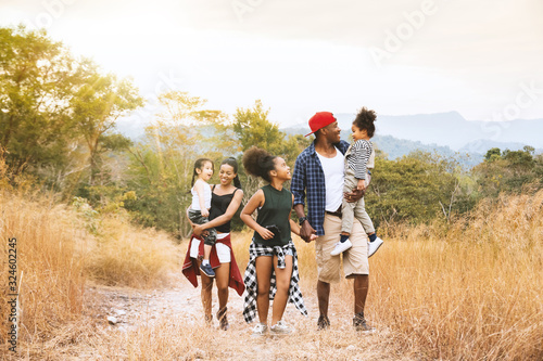 Obraz na plátne Happy mixed race big family with father, mother and child daughter walking on country road