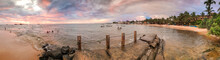Beautiful Panoramic Image Of Old Pier On The Ocean Beach At Sunset