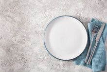 Empty Plate Fork Knife On Conc...