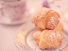 Three Crispy Croissants On A S...