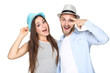 Happy young couple in straw hats on white background