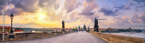 Obraz City summer landscape at sunrise - view of the Charles Bridge in historical district of Prague, Czech Republic - fototapety do salonu