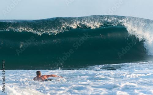 Photo Surfer surfing at sunset, Bondi Beach, Sydney