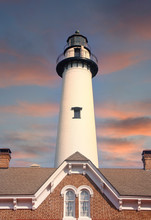 A White Brick Lighthouse Beyon...