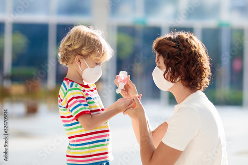 Mother and child with face mask and hand sanitizer - 324705814