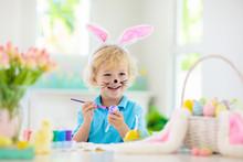 Kids On Easter Egg Hunt. Child...