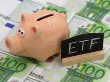 Piggy Bank And Blackboard Which Shows ETF On Hundred Euro Banknotes, Concept Of Exchange-traded Fund Investment