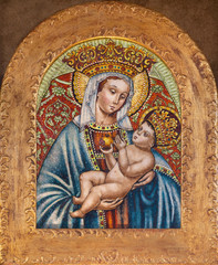 FERRARA, ITALY - JANUARY 30, 2020: The ceramic Madonna in church Basilica di San Giorgio fuori le mura as the copy of original of image from year 1504 by Marcello Miani 1984.