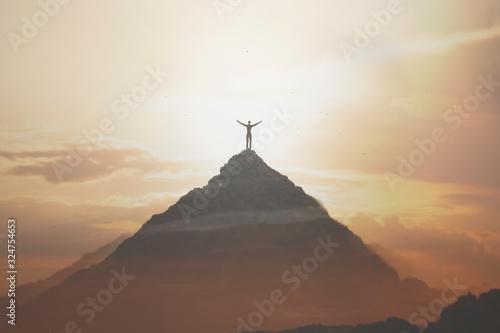 Fototapeta man taking a breath in peak of the montain