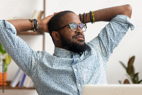 Fotomural Dreamy African American businessman relaxing after finished work