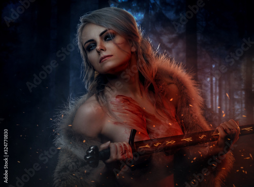 Fotomural Beautiful naked woman with blood stained skin holding a long sword in night forest