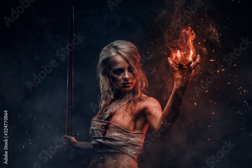 Fantasy woman warrior wearing rag cloth stained with blood and mud in the heat of battle Fototapete