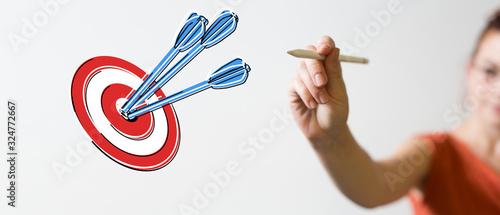 Cuadros en Lienzo arrow hitting in the target center of dartboard on bullseye.