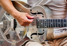 Closeup Shot Of A Male Playing The  Silver Iron Guitar